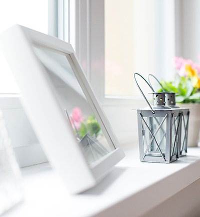 close up image of a window sill with photo frame