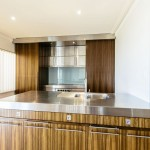 Kitchen with industrial bench tops and wooden cabinetry