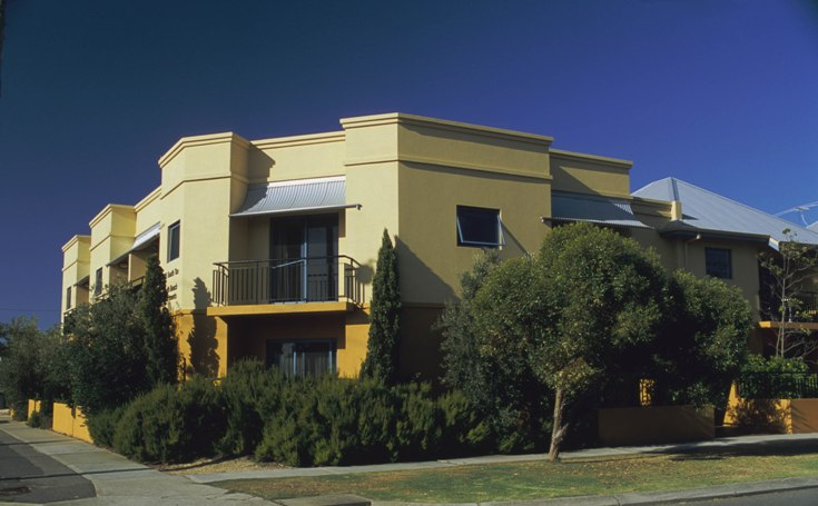 Yellow apartment building exterior
