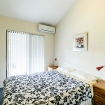 Bedroom with aircon and wooden bedside tables